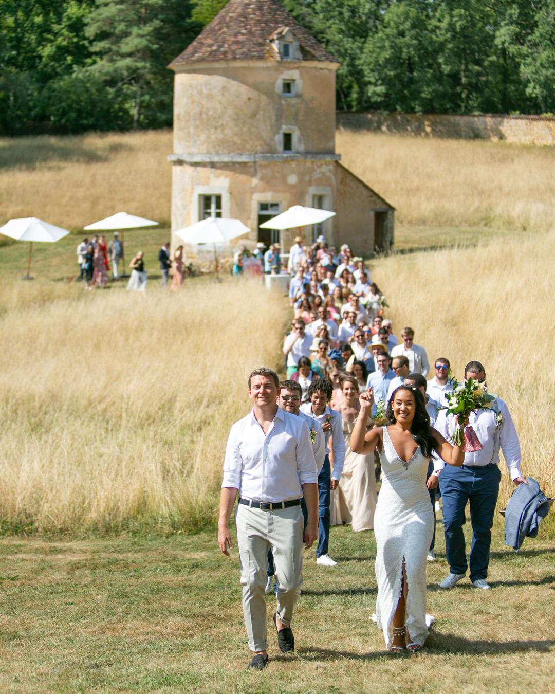 jen tim wedding people walking through field