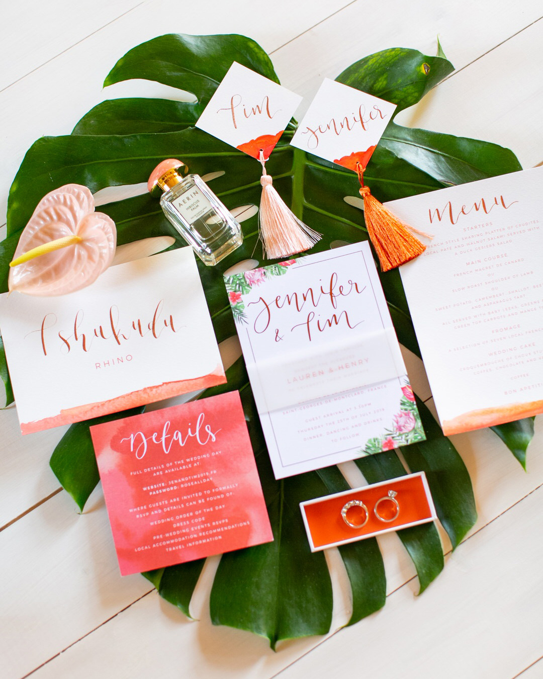 jen tim wedding tropical pink invites on giant leaf
