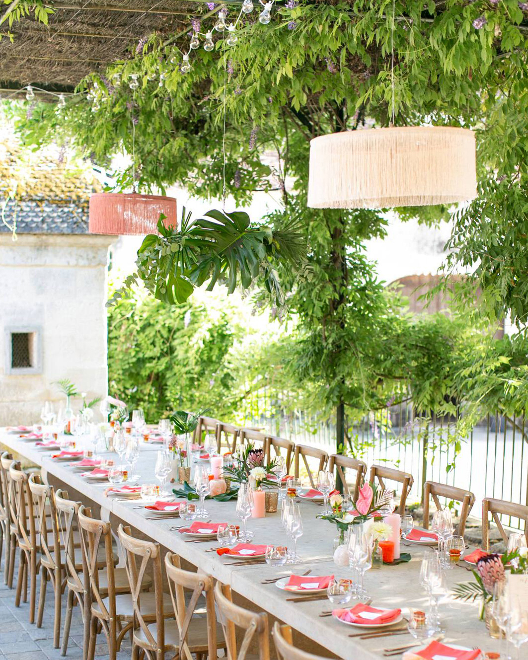 jen tim wedding reception elegant tropical decor on long table