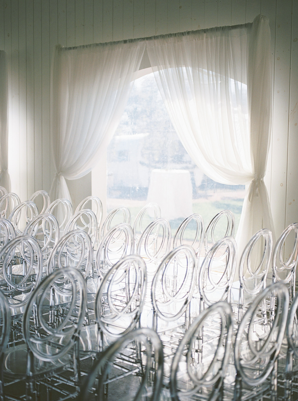Lucite chairs used for wedding ceremony