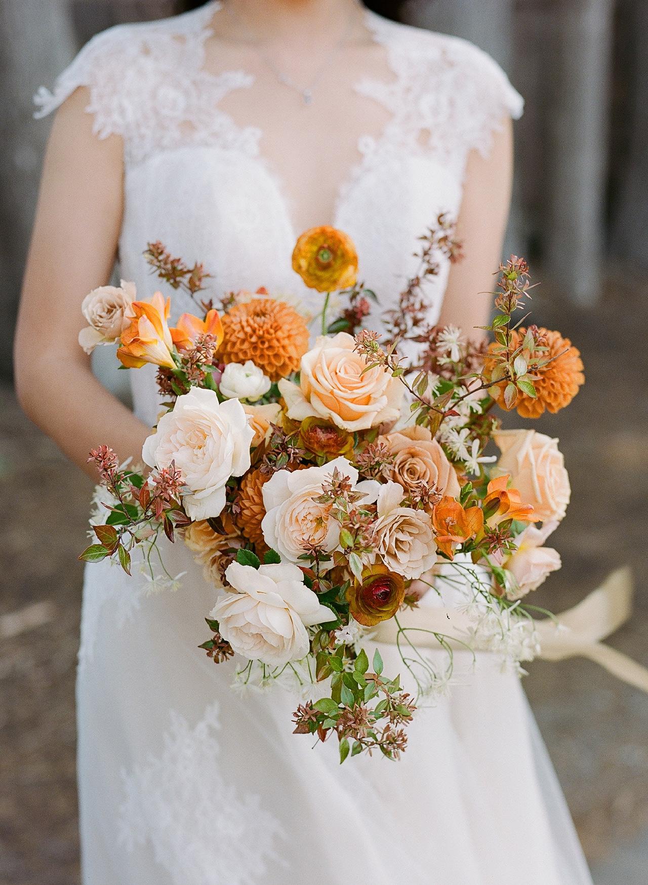 bride ceremony bouquet orange accent
