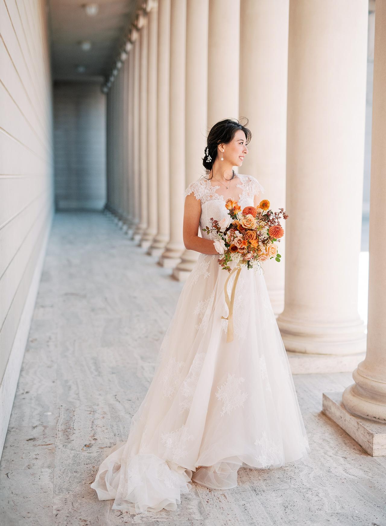 bride lace and organza wedding dress autumn bouquet