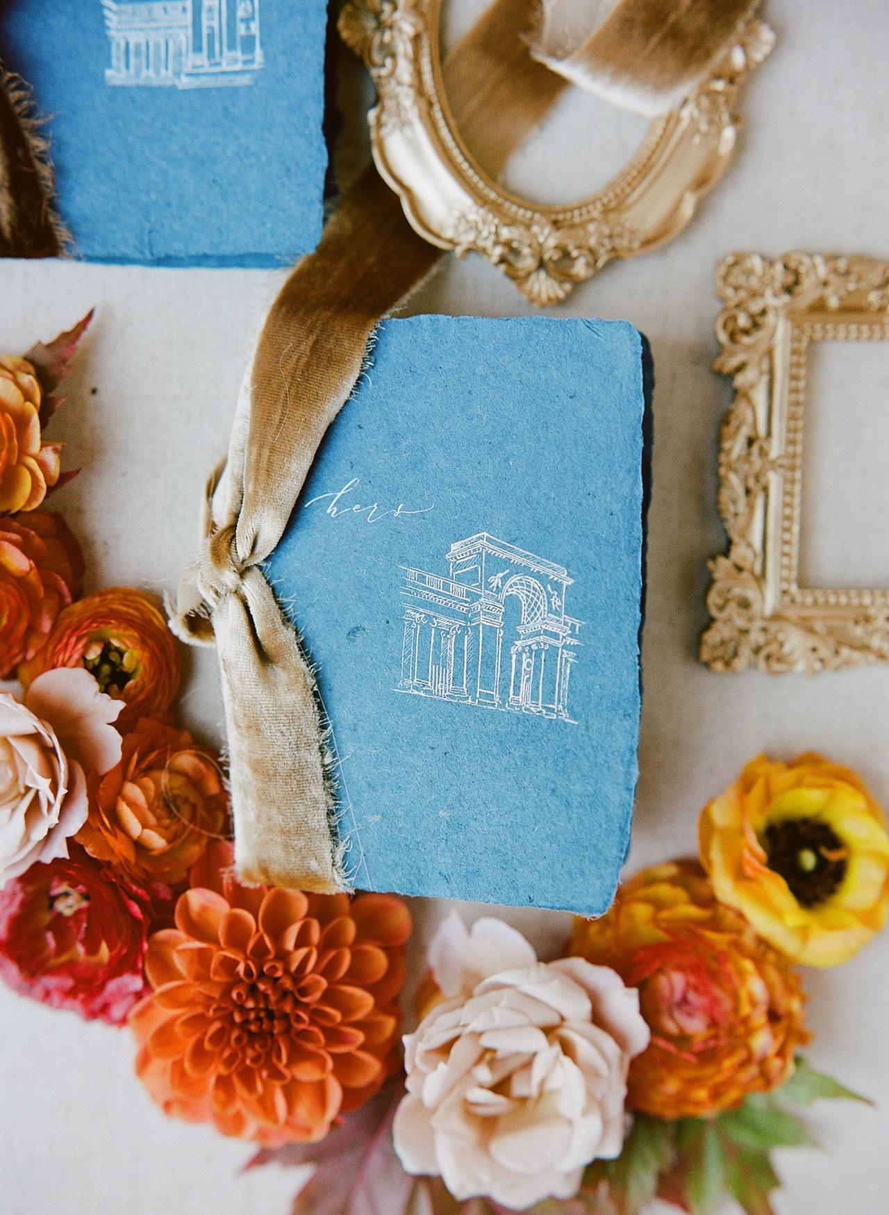 blue vintage-inspired vow books deckled edges