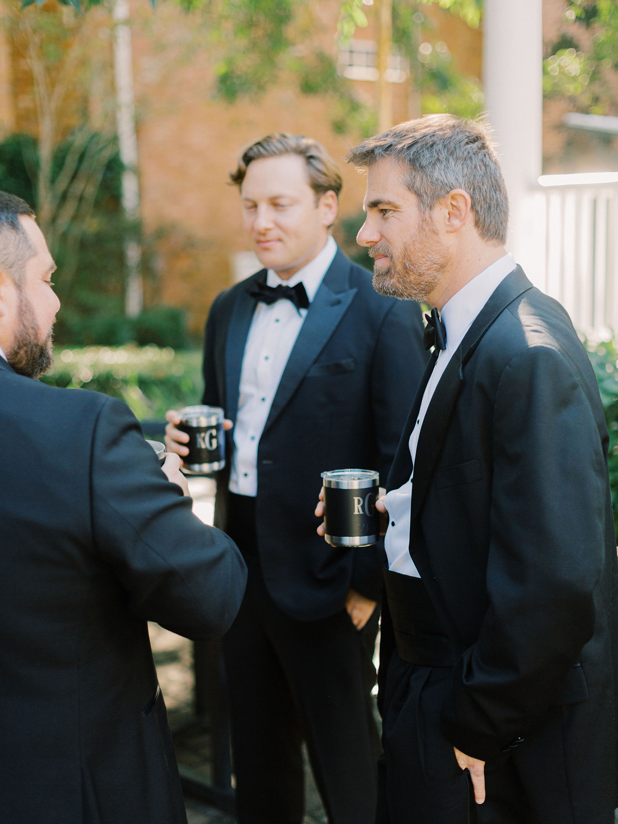megan parking wedding men with monogrammed drinking vessels