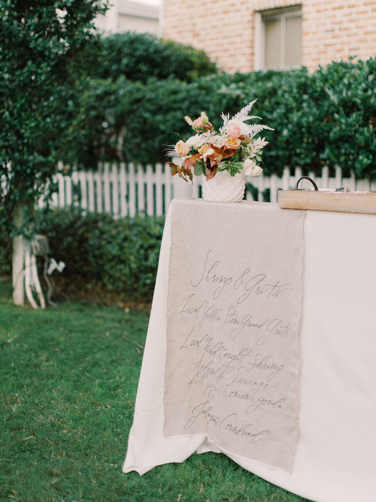 megan parking wedding menu handwritten on decorative linen
