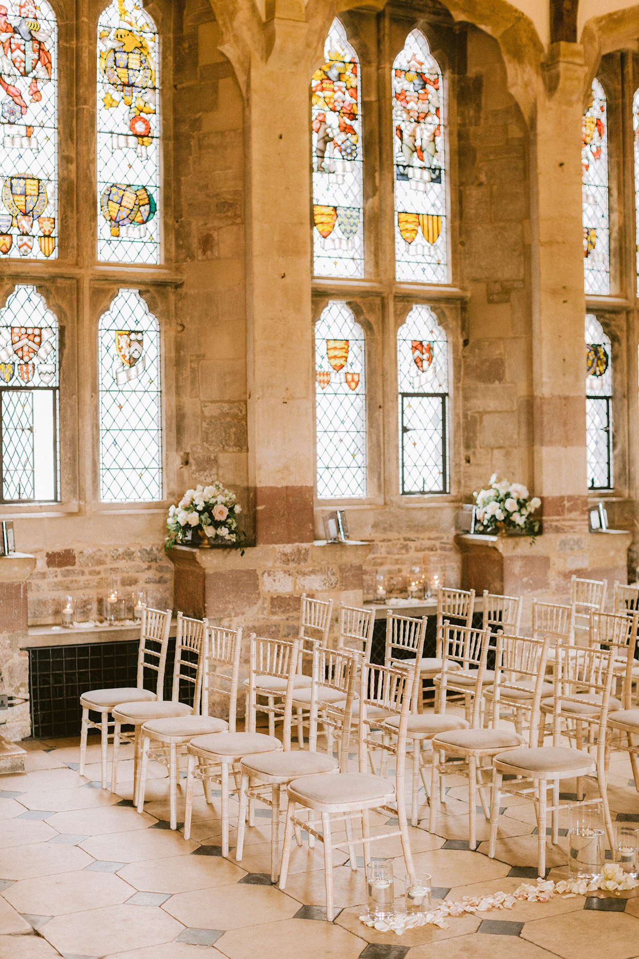 wedding ceremony while elegant chairs in stained glass room