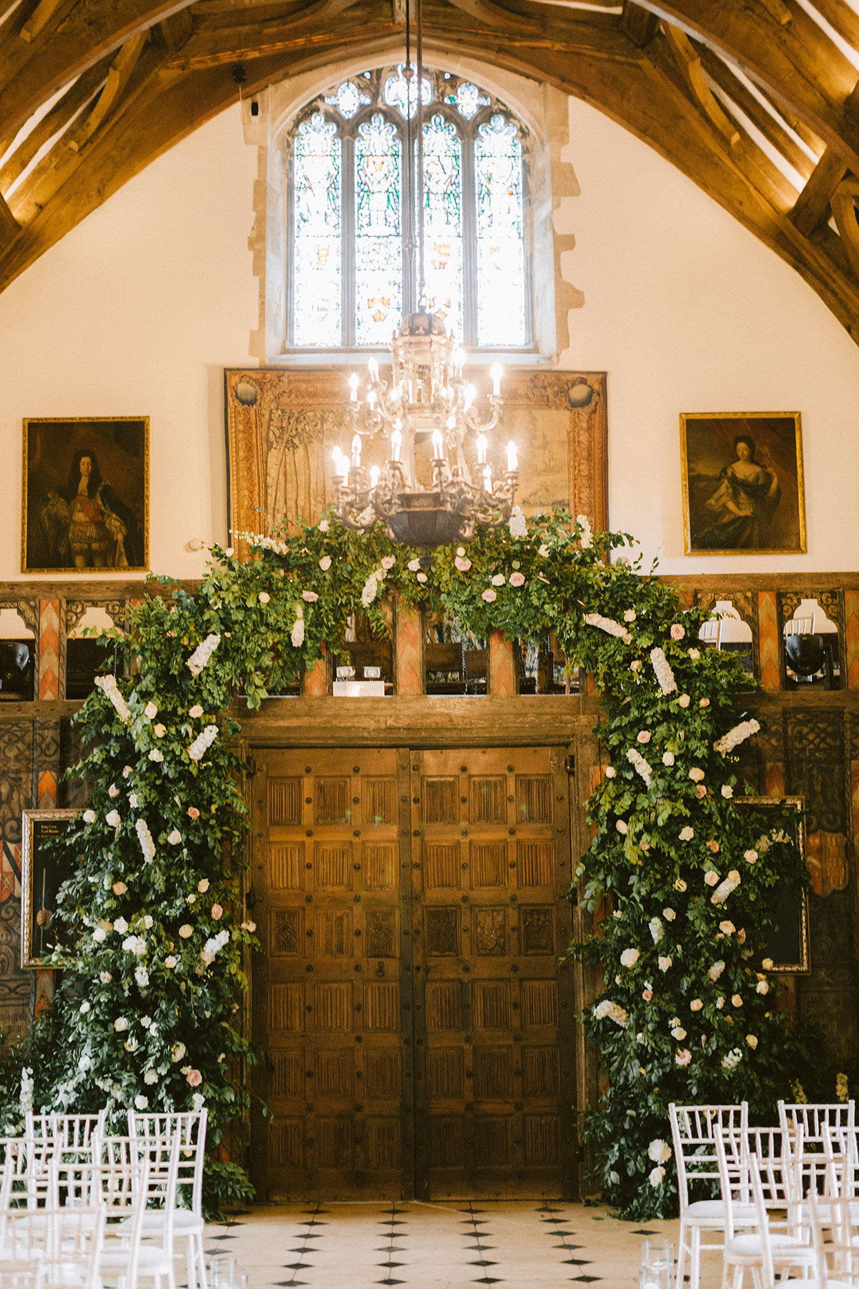 emma mike wedding antique door entry with floral arch