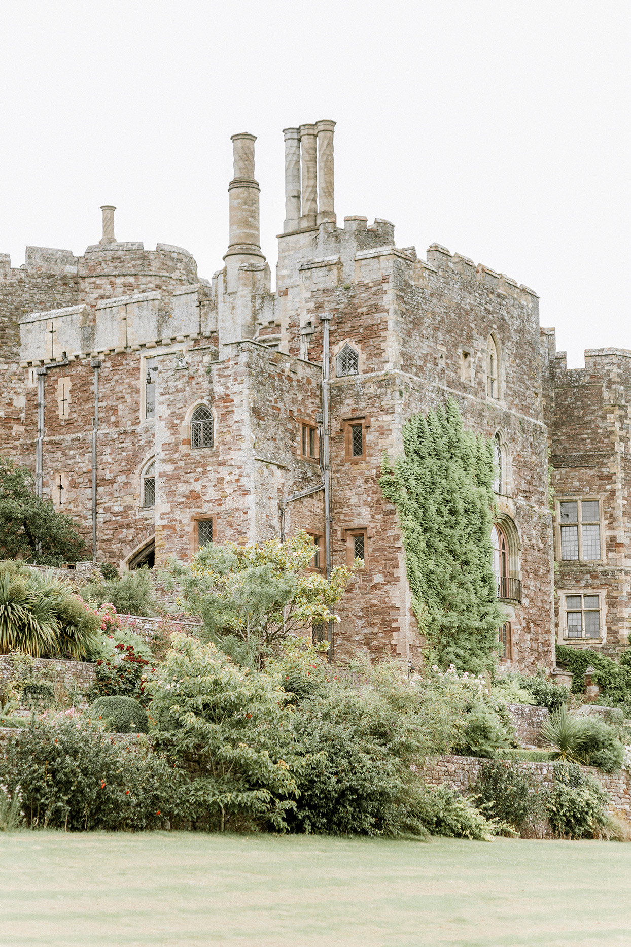 wedding stone castle venue positioned in trees