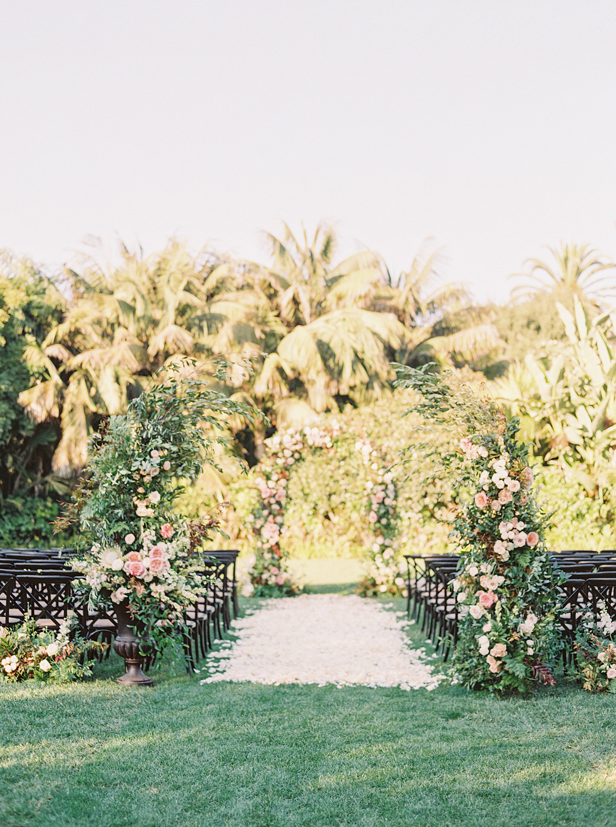 corey evan wedding floral arch at outdoor ceremony on lawn