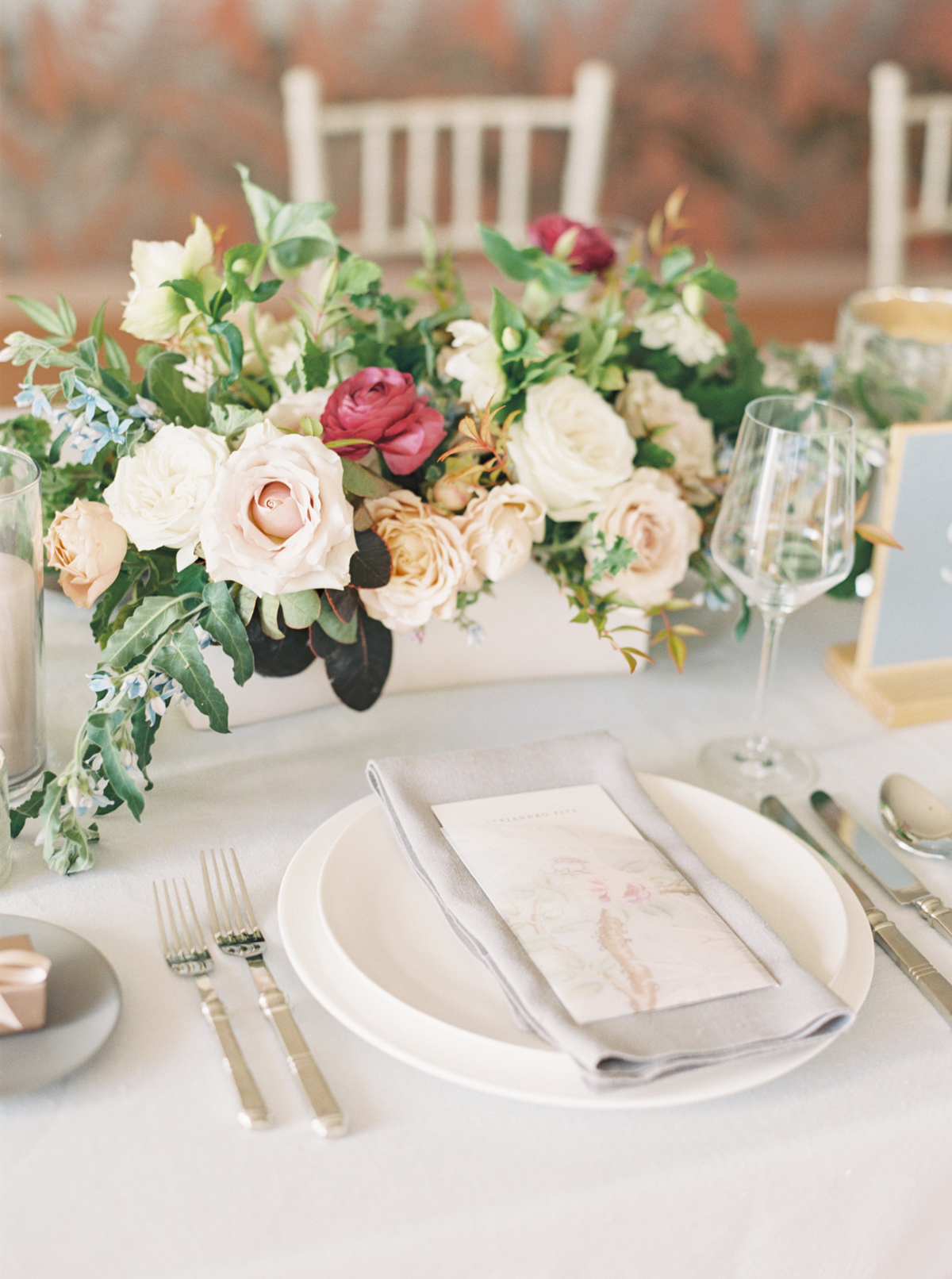 corey evan wedding neutral place setting with floral bouquet