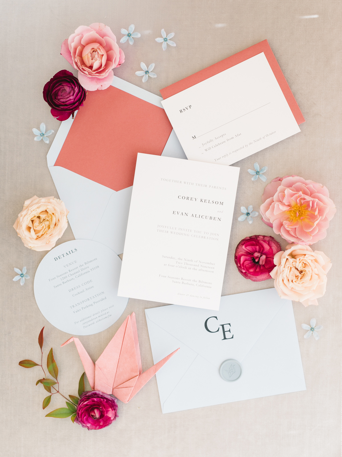 coral and cream wedding invitations with flower and crane accents