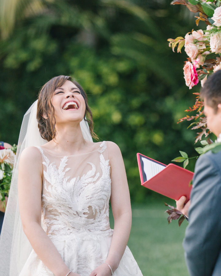 bride laughing during ceremony vows