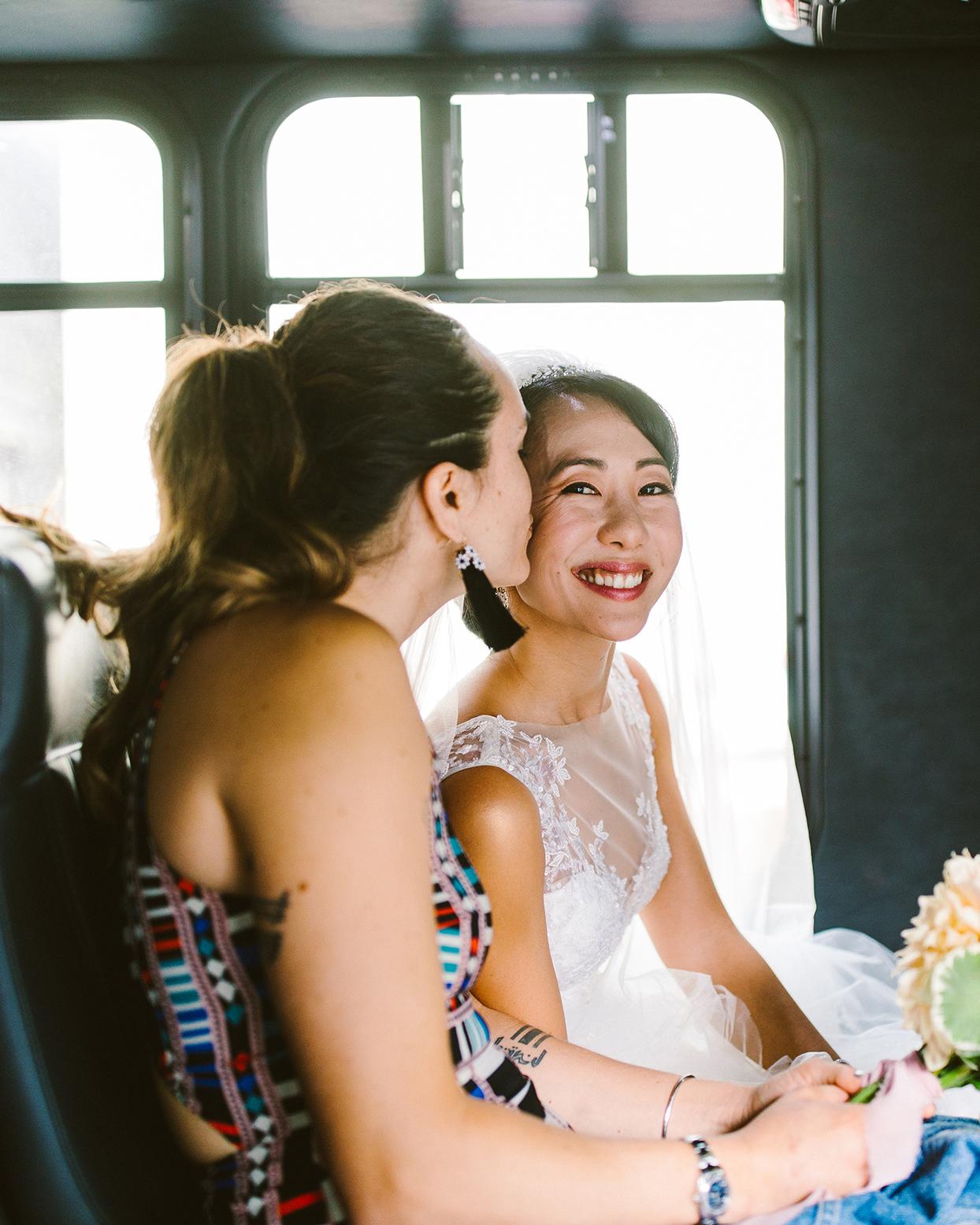 bride and bridesmaid on wedding bus