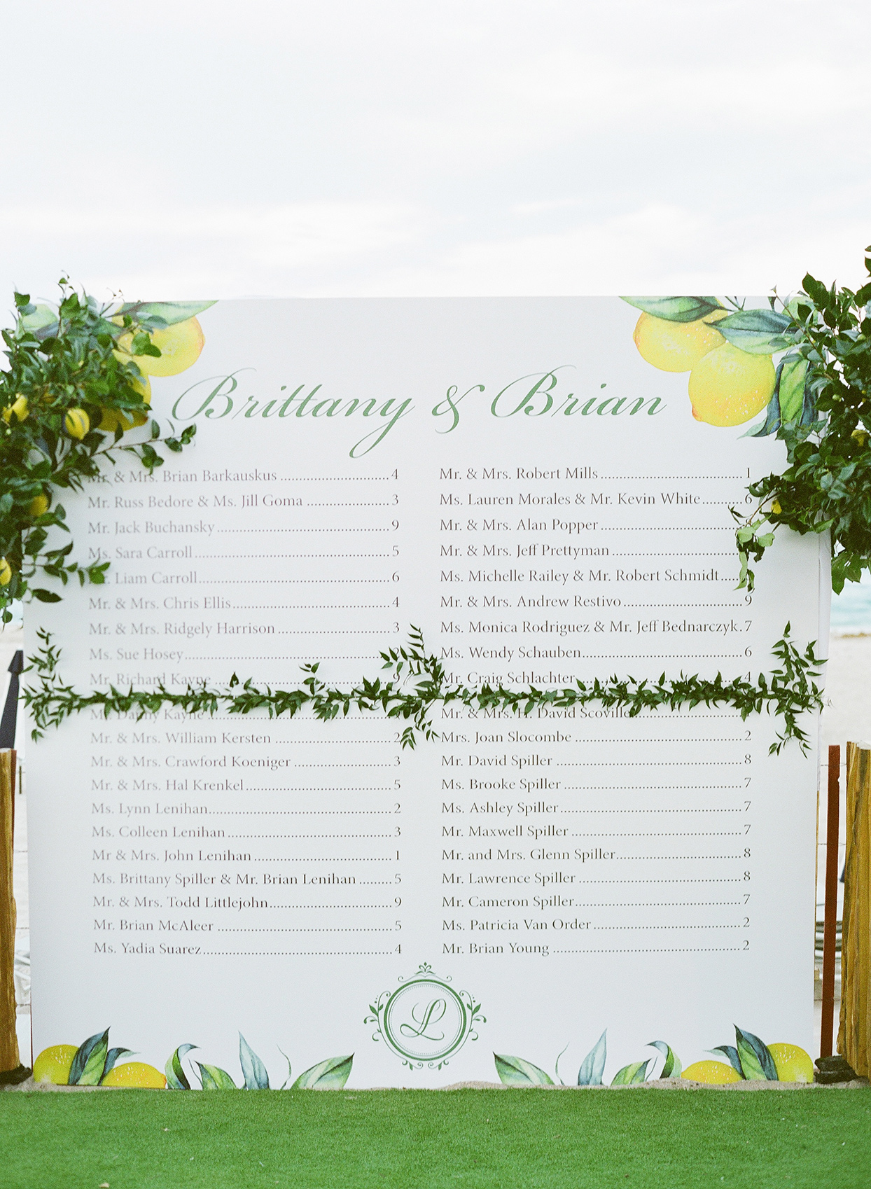 brittany brian wedding large white seating chart board with citrus and greenery decor