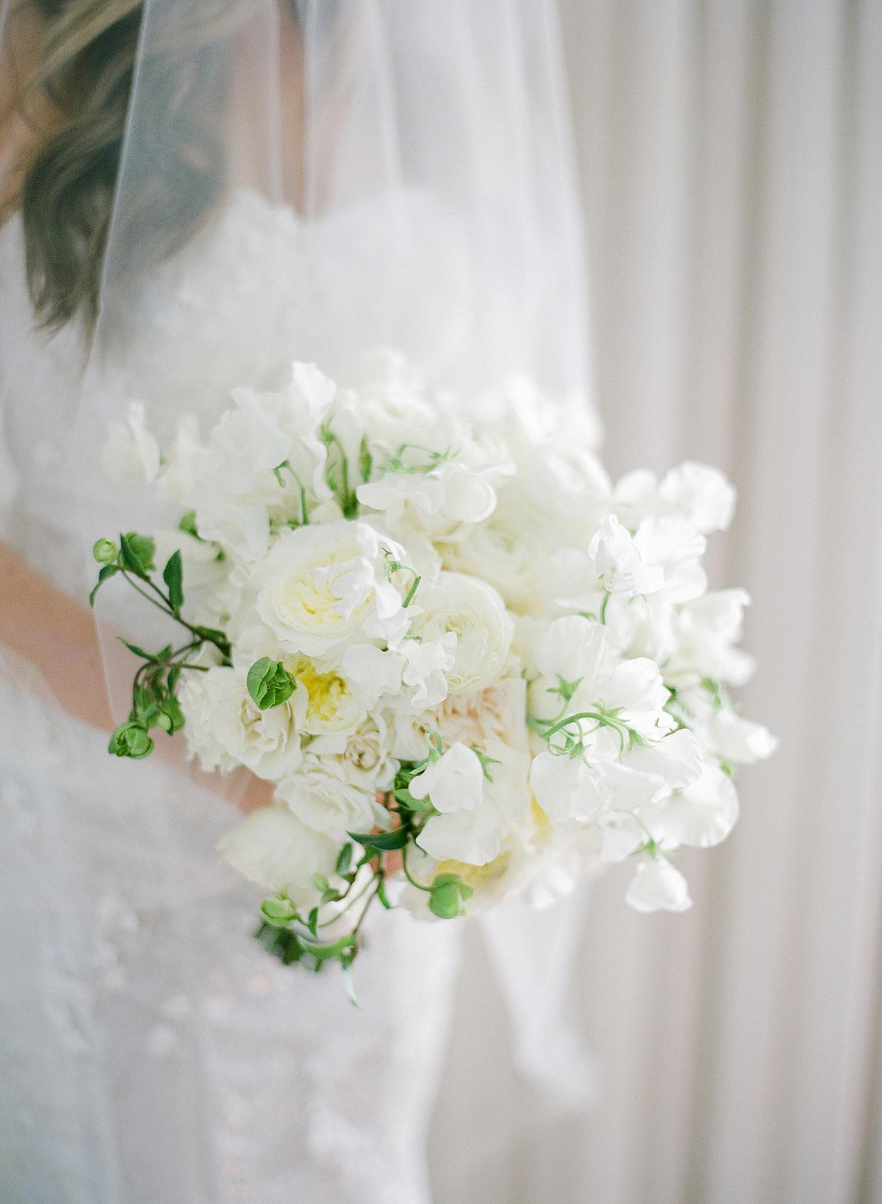 brittany brian wedding bride's white floral bouquet in her hands