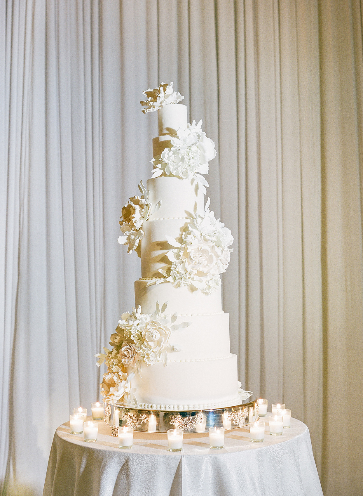 brittany brian wedding tall cake with floral decor