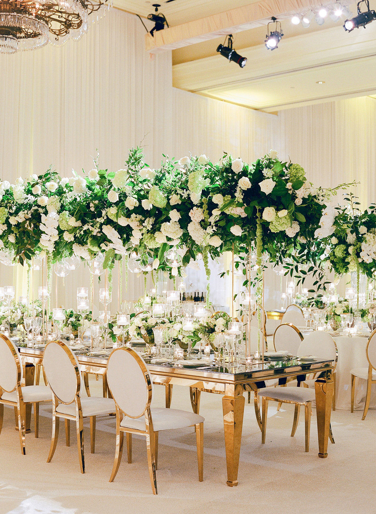 brittany brian wedding reception elegant gold tables with large floral centerpieces