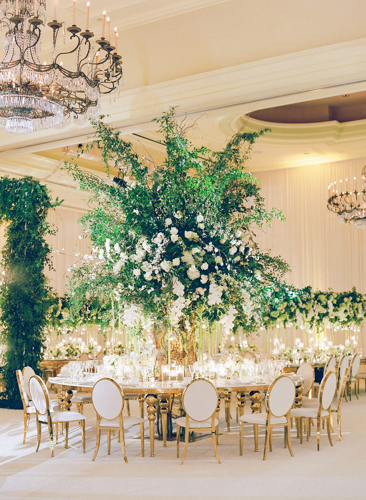 brittany brian wedding reception round table with large floral centerpiece in the middle