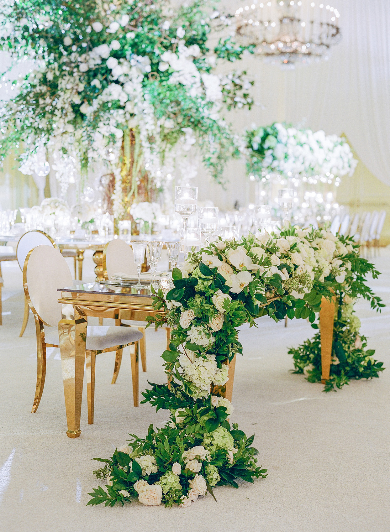 brittany brian wedding sweet heart table with floral garland