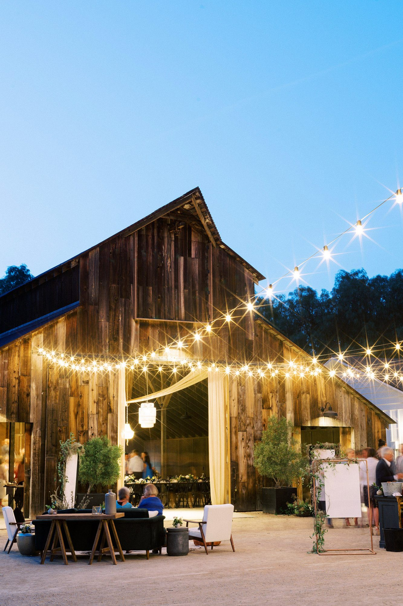 Caitlin and Fletcher wedding barn lights