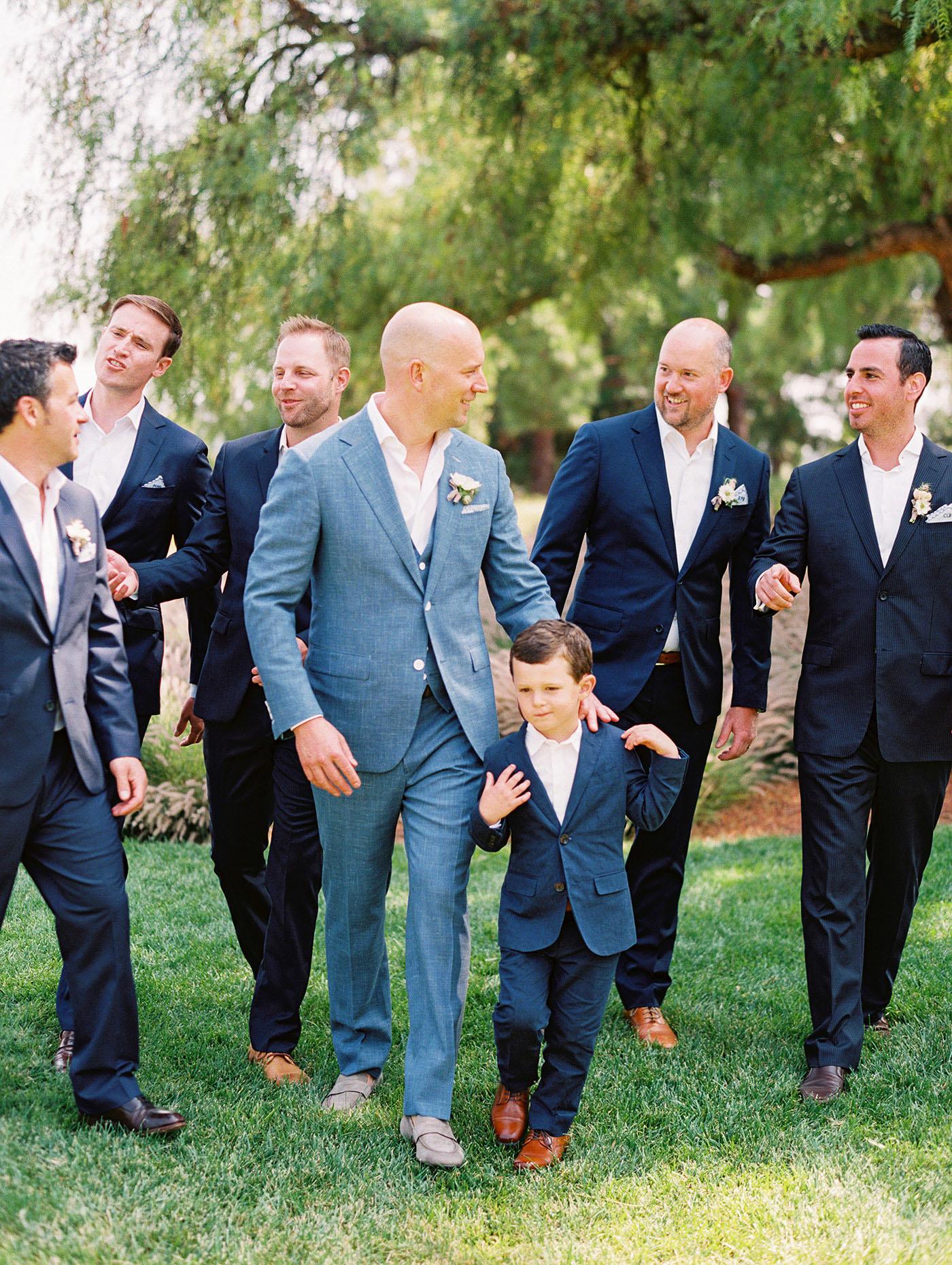 Caitlin and Fletcher wedding groomsmen and groom