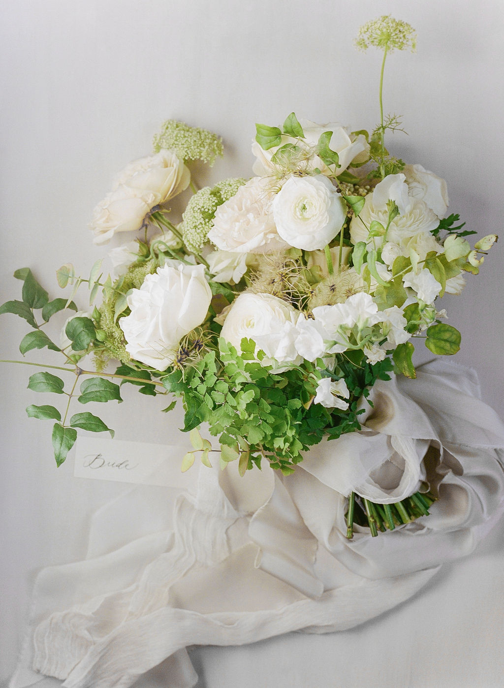 bouquet of white garden roses and queen annes lace