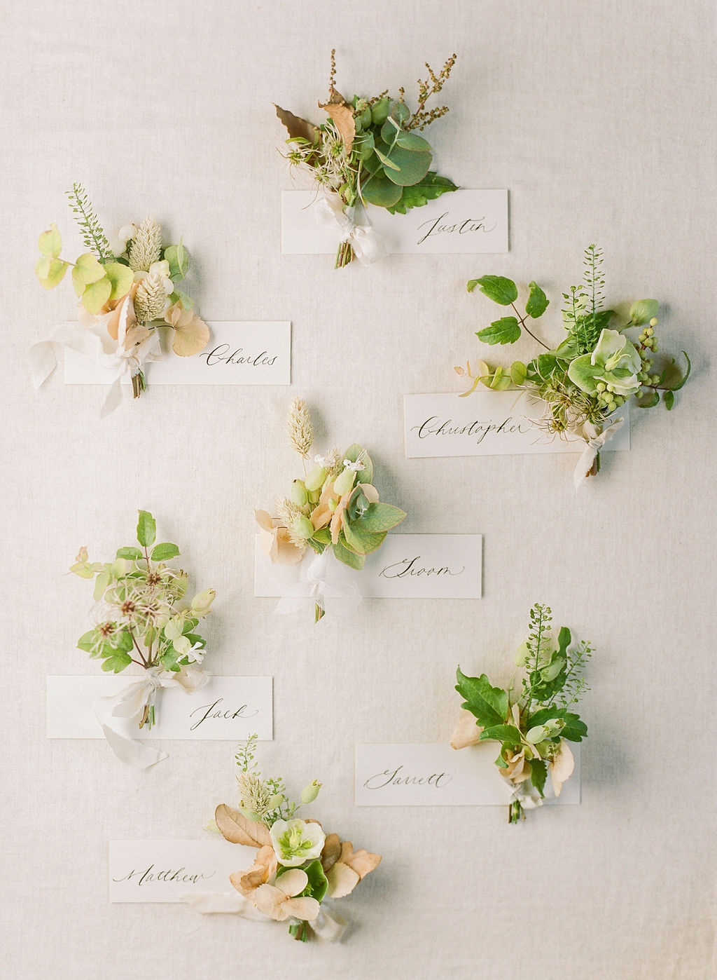 boutonnieres with dried and fresh plants