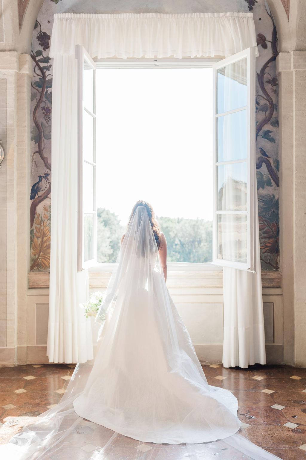 bride gazing out open window