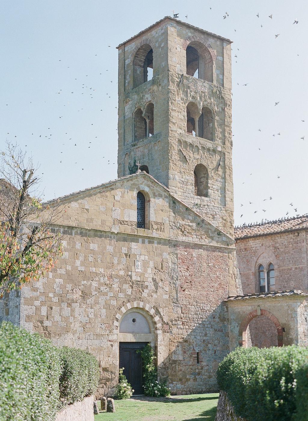 birds flying above chiesa di san giovanni battista