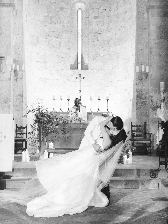 groom dipping bride in italian church