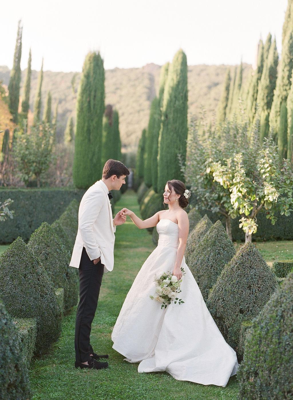 bride and groom posing in italian garden