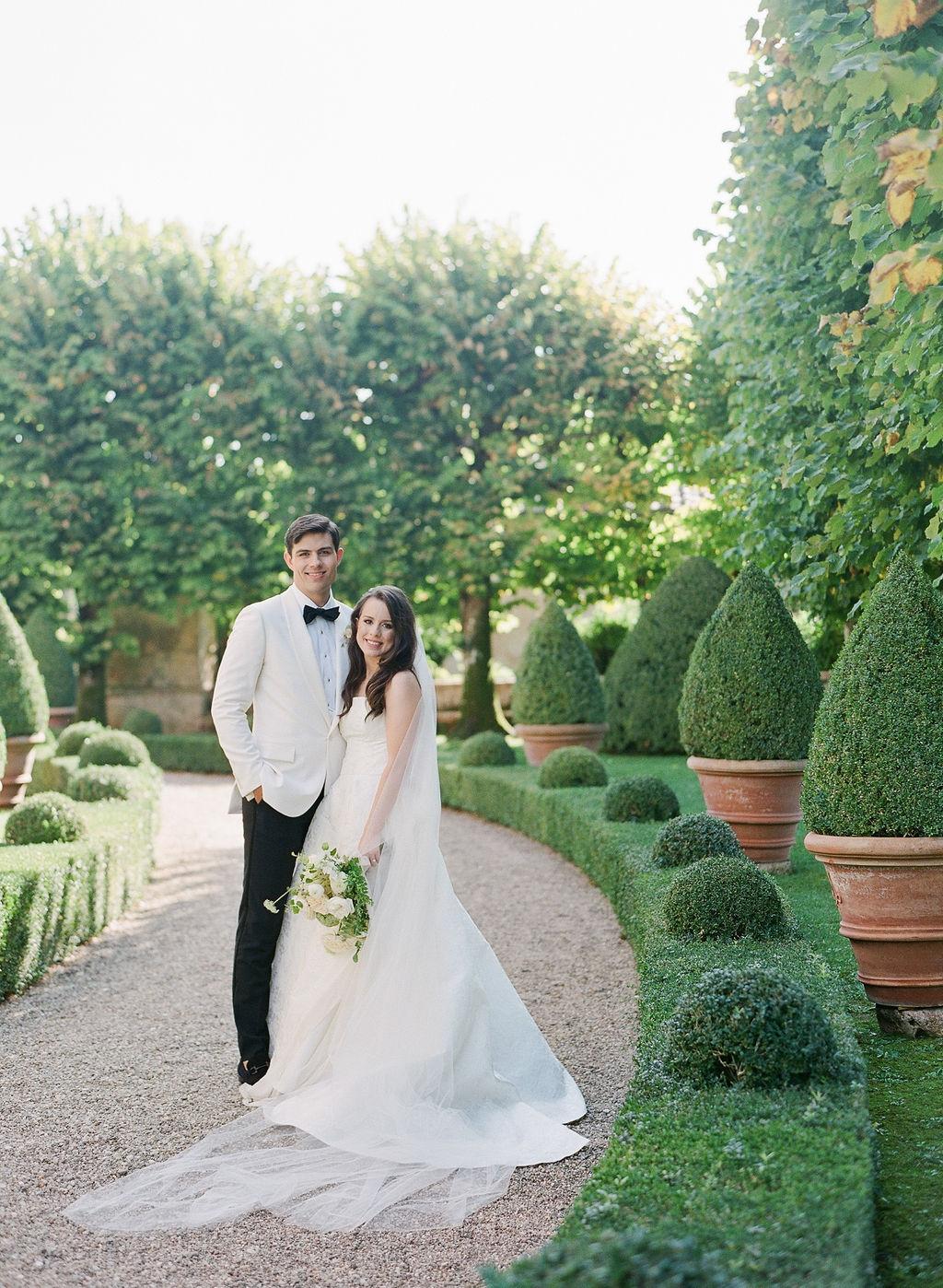 bride and groom smiling in italian garden