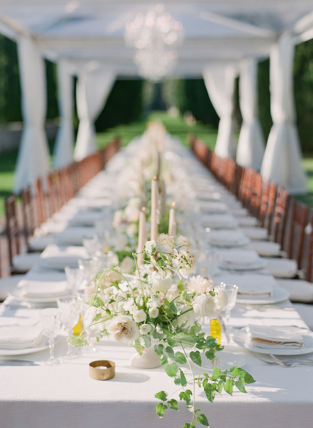 all white tablescape with white rose centerpieces