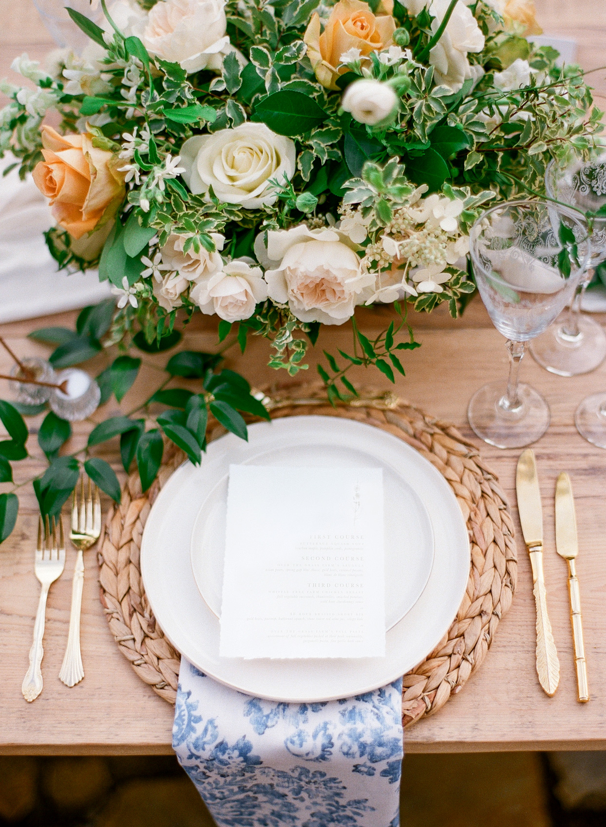 gold cutlery and blue floral linen wedding place settings
