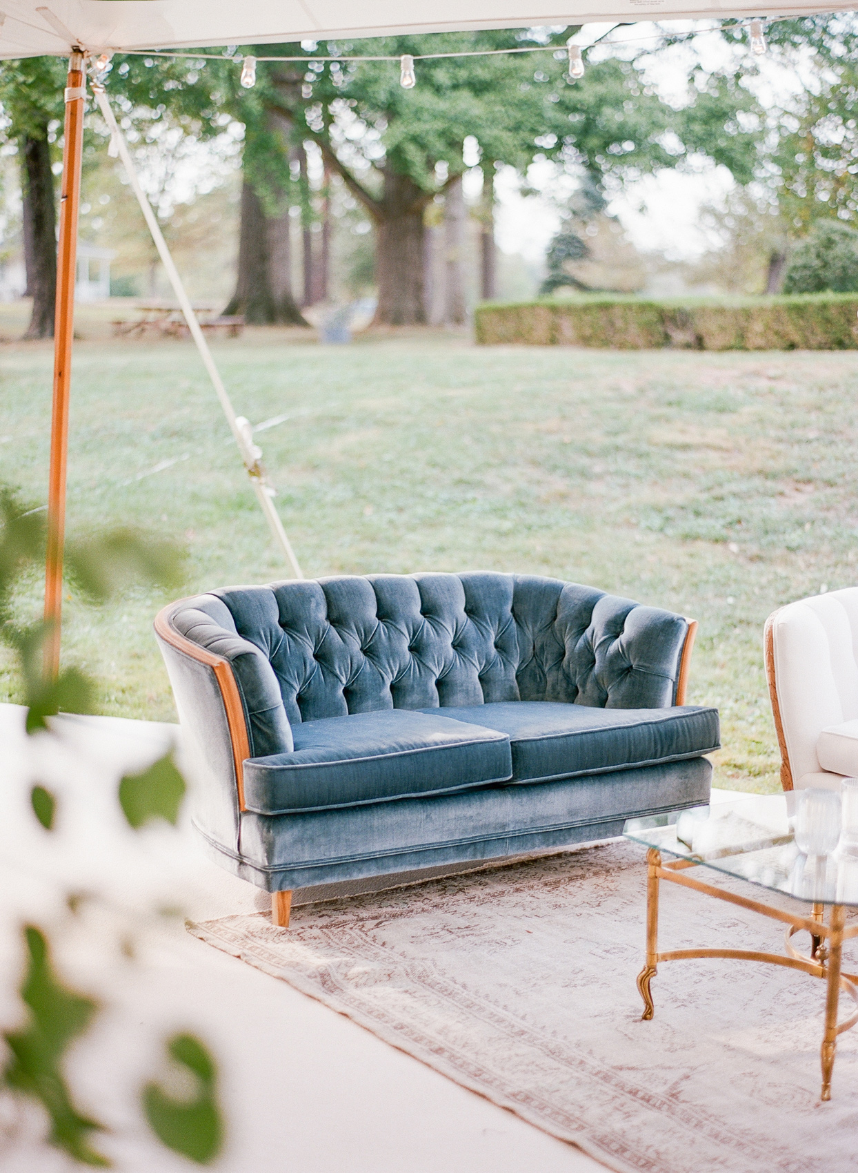blue velvet couch wedding lounge under reception tent