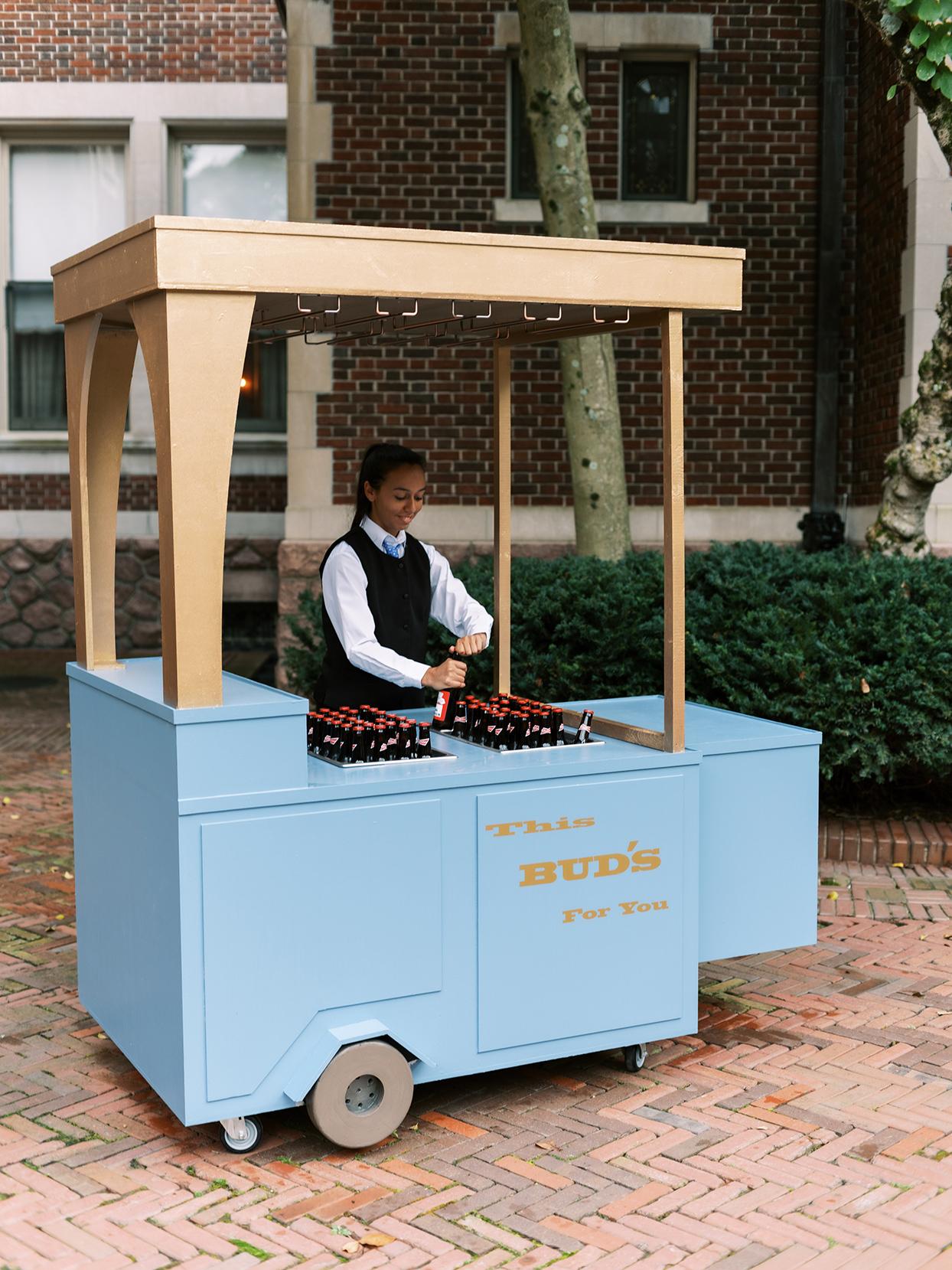 lauren chris wedding woman serving beer from budweiser cart