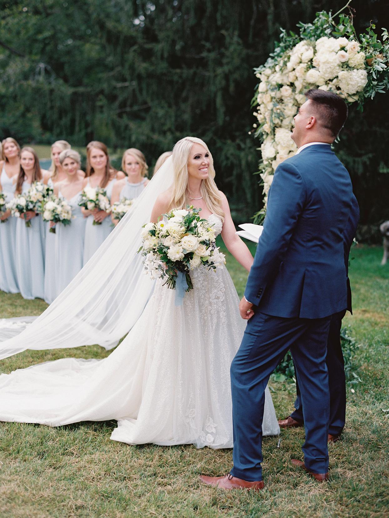 lauren chris wedding ceremony couple saying vows