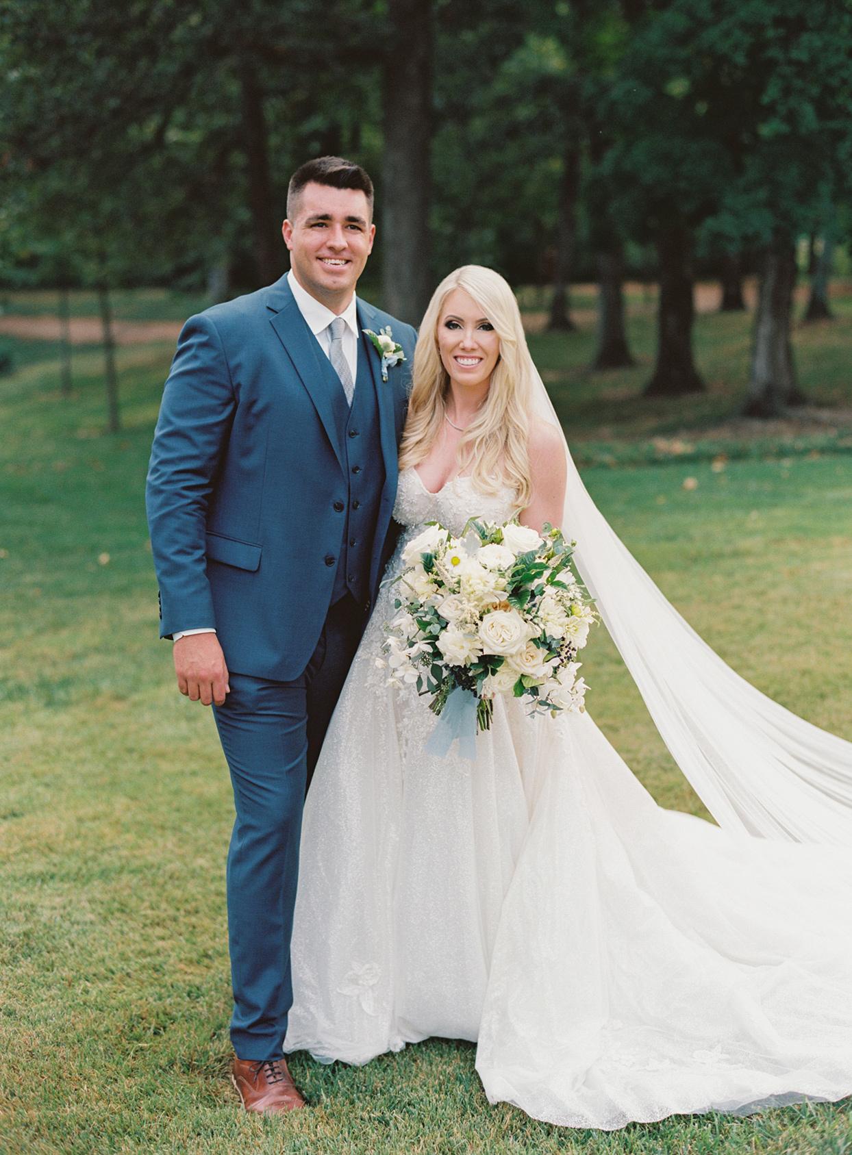 lauren chris wedding couple portrait on the lawn