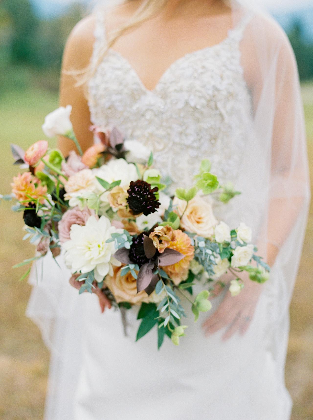 bride roses dahlias ranunculus lisianthusfloral bouquet