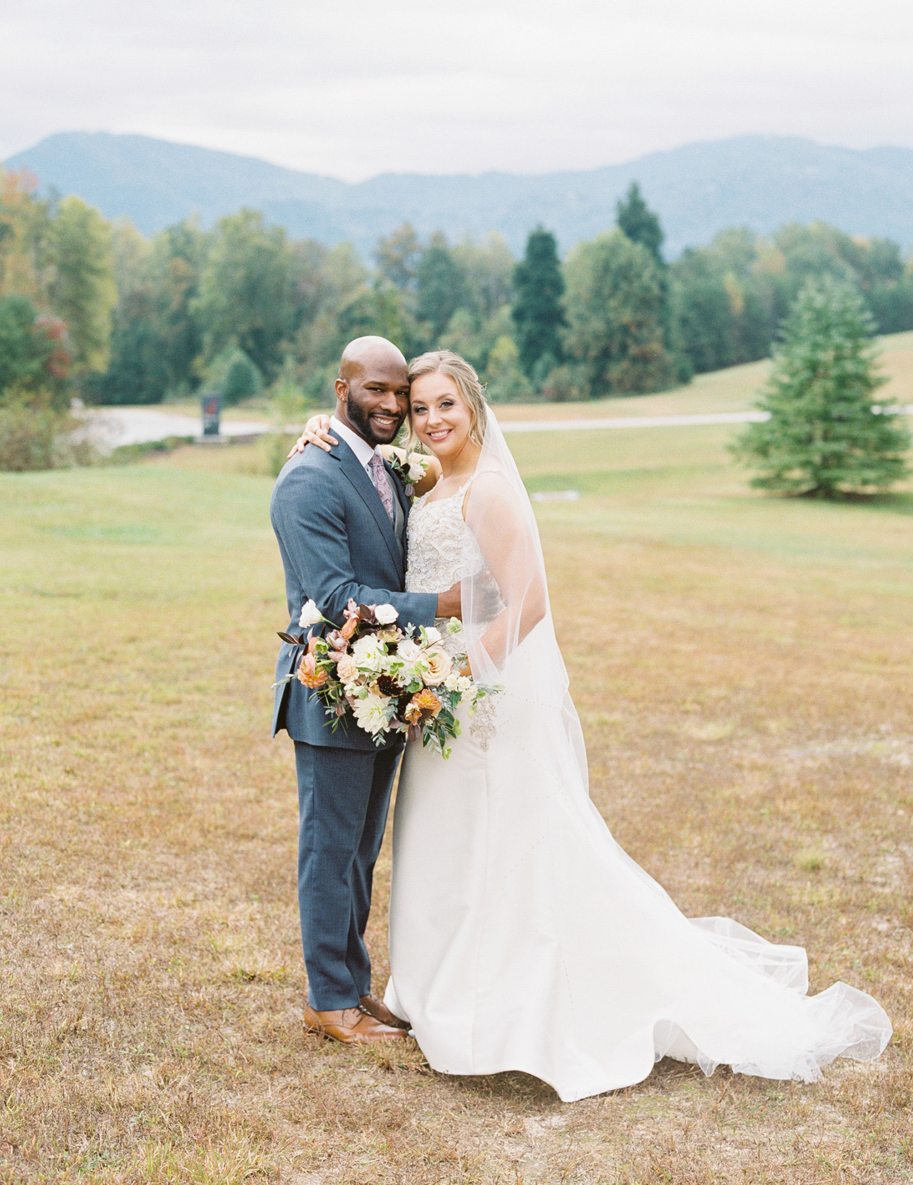 bride groom pose in wedding attire outdoor mountain view