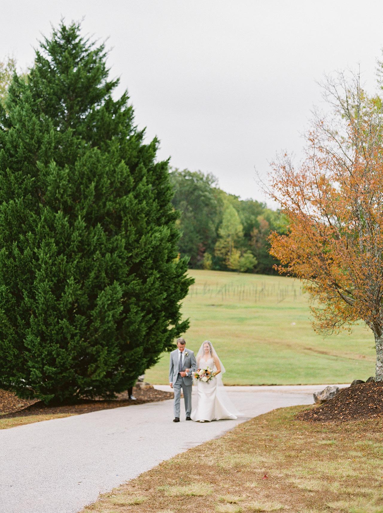 father bride precessional outdoor sidewalk
