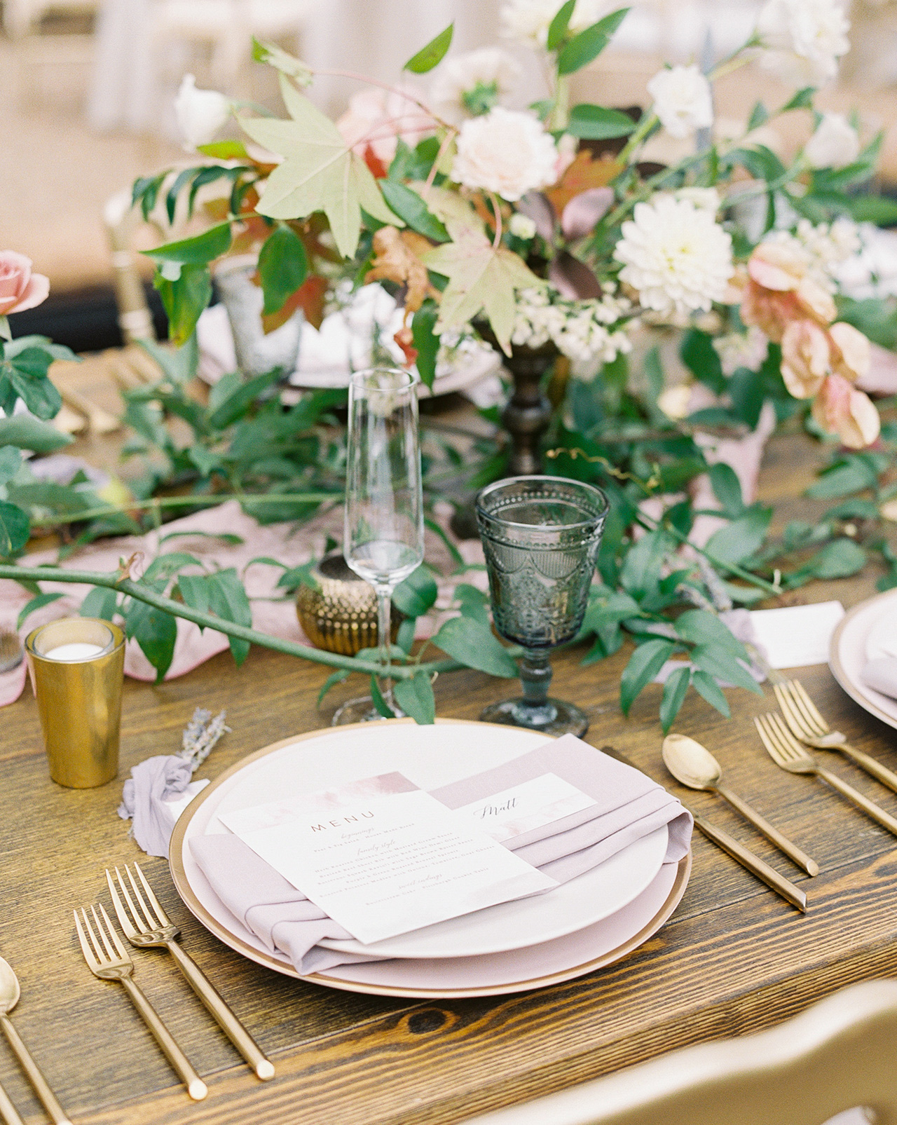 Ivory plates gold flatware blush glassware wooden tables