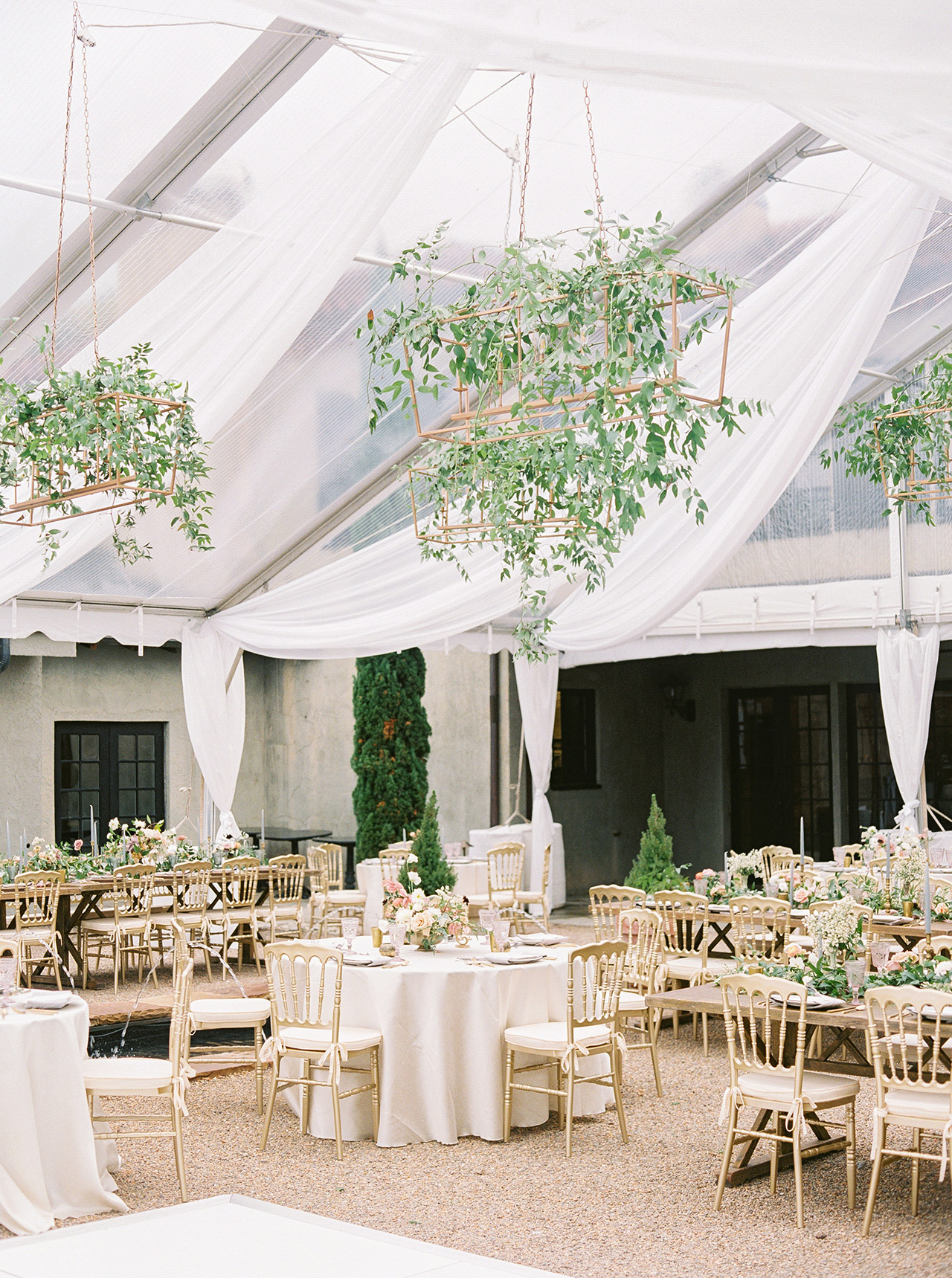 sheer runners and floral garlands reception table area