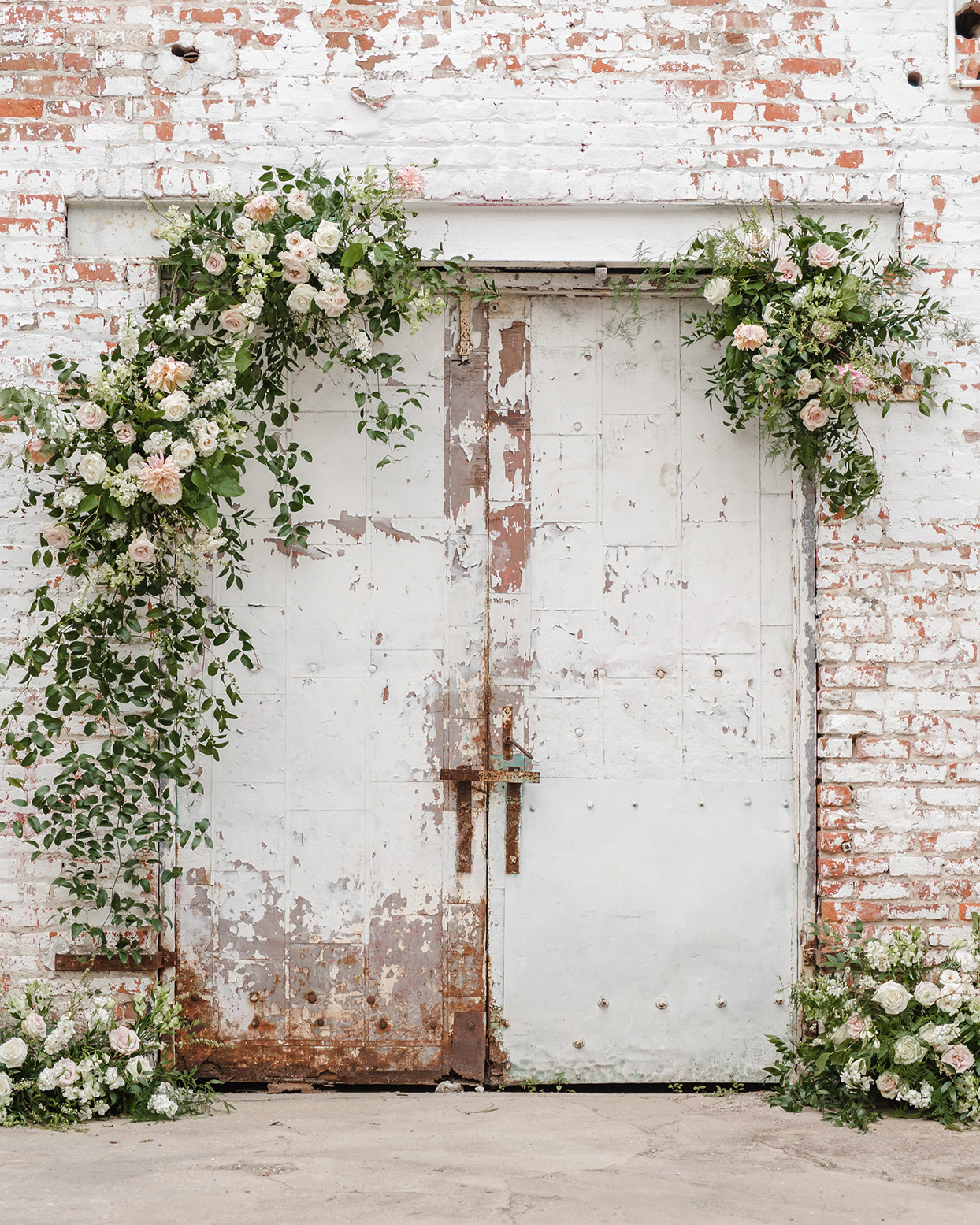 outdoor courtyard area of warehouse with flowers