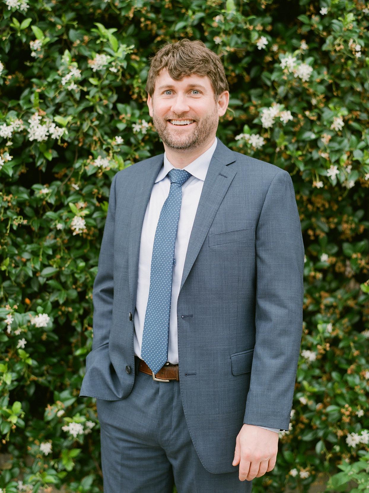 Groom wearing navy blue textured suit and tie