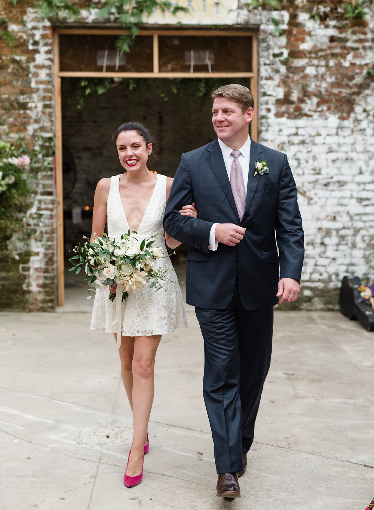 Bride walking down aisle with brother