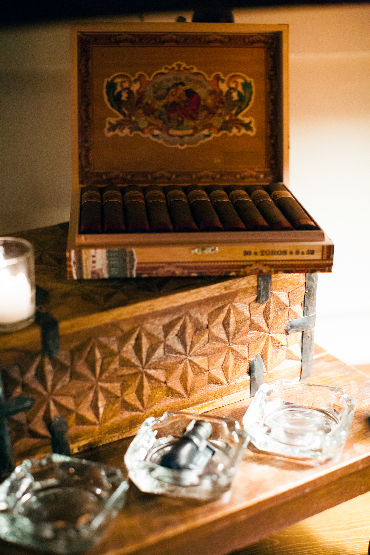 ornate cigar box on wooden table at welcome party