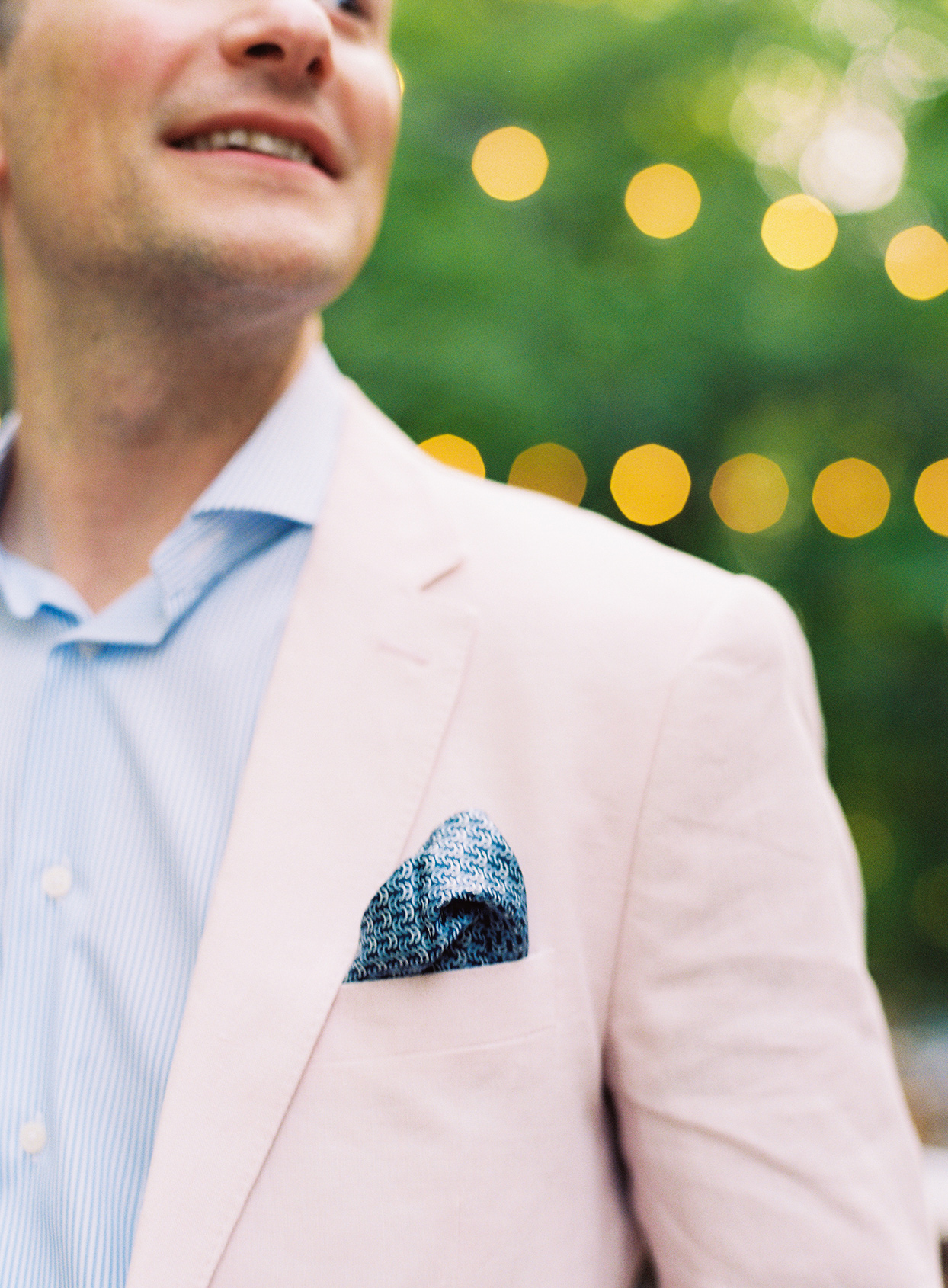 blue patterned pocket square in groom's pastel pink suit