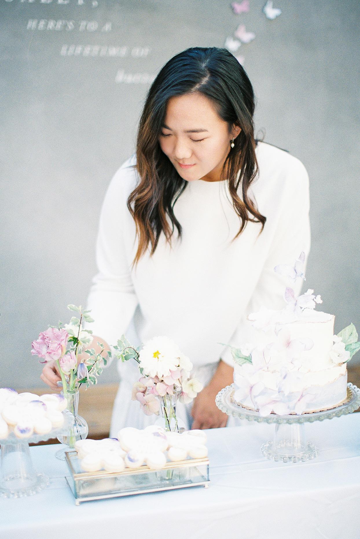 bride holding flowers at pastel shower