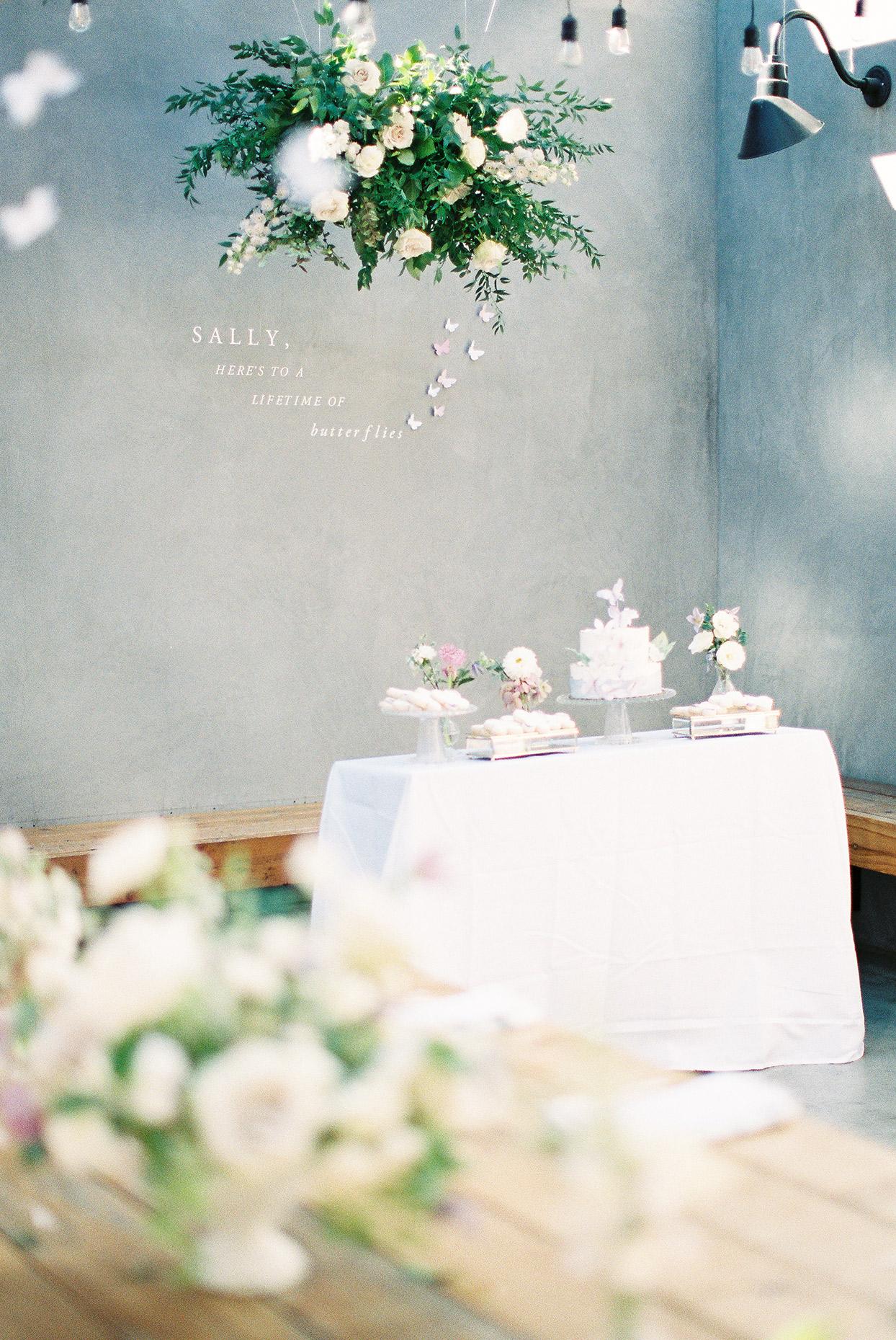 sally bridal shower flower installation on wall